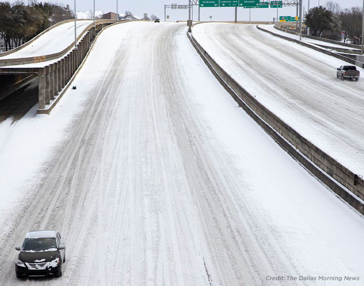 snow and ice cover the roads in Texas during winter storm Uri