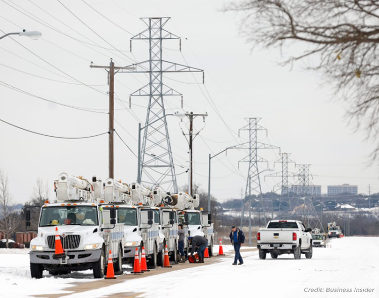 power maintenance trucks line up during winter storm Uri