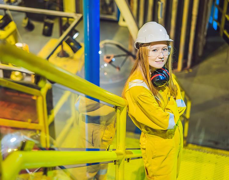 Woman in NDT in an oil refinery